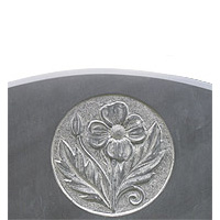 Carved poppy on slate